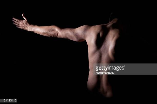 in the darkness - human back stock pictures, royalty-free photos & images