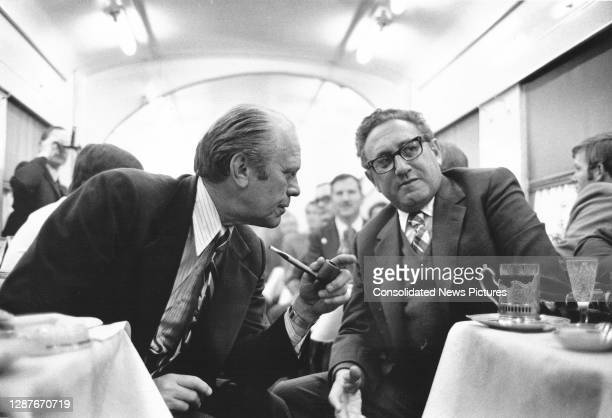 In the dining car of the train from the airport, US President Gerald Ford talks with Secretary of State Henry Kissinger, Vladivostok, USSR, November...