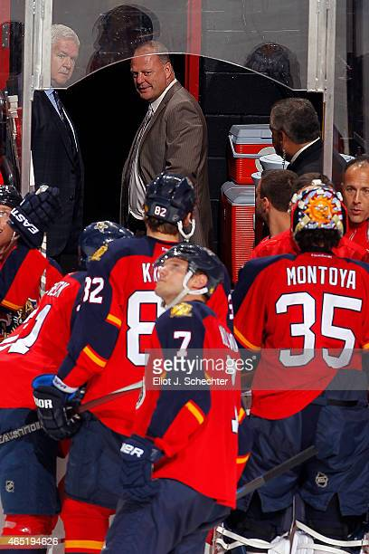 In the doorway of the dressing room Head Coach Gerard Gallant of the Florida Panthers chats with team General Manager Dale Tallon after second...