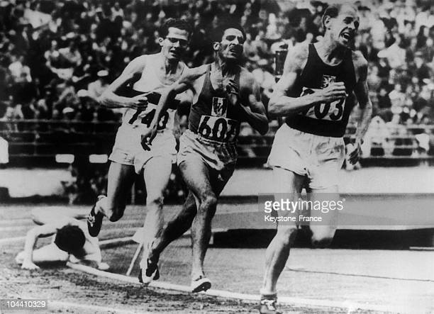 In the dramatic finish to the 5000 metres in the '52 Olympics Britain's Chris Chataway falls on the final bend as Emil Zatopek of Czechoslovakia...