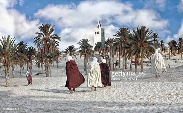 In the dunes of Marrakesh the call to prayer men walk to the desert mosque