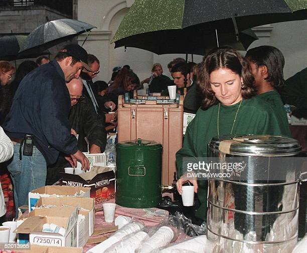 In the early hours of the morning 04 September members of the 'Harrods' staff supply free refreshments to the crowds that have been growing long The...