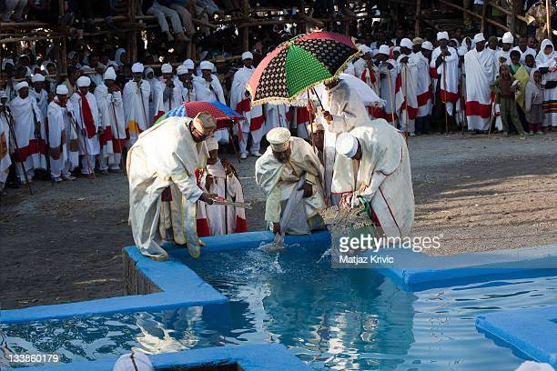 In the early hours of the morning a body of water is blessed and the faithful reenact the baptism of Christ on Timkat festival in Lalibela January 19...