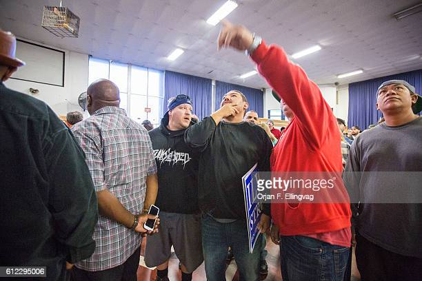 In the early hours of the morning workers wait to be called for jobs at the Local 13 Longshore Workers Dispatch Hall in Los Angeles All available...