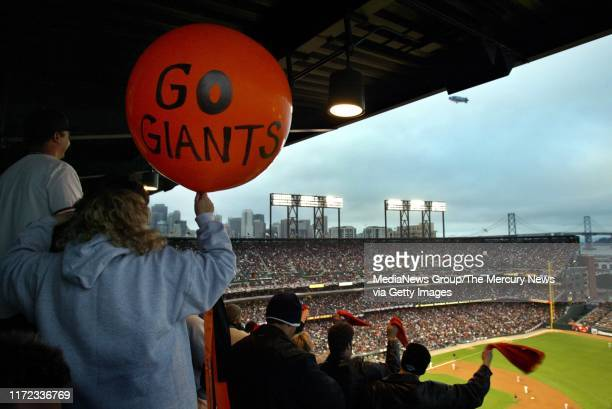 In the early innings San Francisco Giants fan Kitty Kotzebue of El Sobrante holds a big balloon given to her by former Giants pitcher Mike Krukow at...