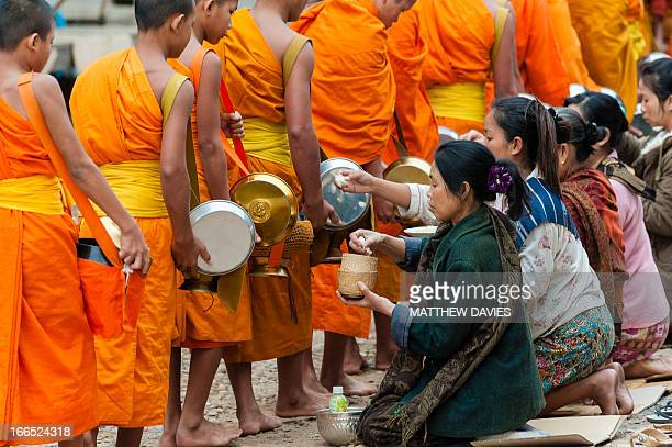 In The Early Morning, Lao Monks Collect Alms From Lao Buddhists In Return For Blessings. In The Town Of Muang Khua, Northern Laos.
