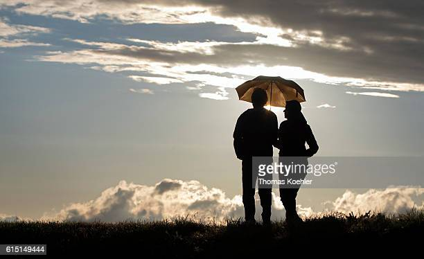 In the evening a couple walks under an umbrella during in the National Park Unteres Odertal on October 02 2016 in Gartz Germany