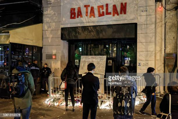 In the evening of november 13th, several people in front of the entrance of the Bataclan concert hall and the commemorative plaque for the victims of...