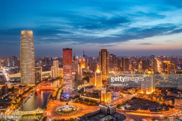 in the evening, the setting sun just set, the bustling city night scene - tianjin stock pictures, royalty-free photos & images