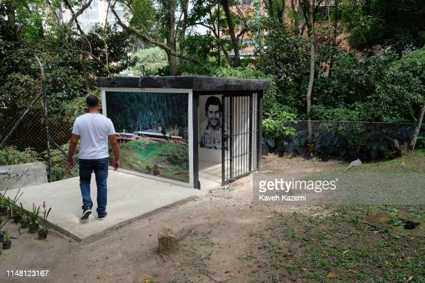 In the family museum of Pablo Escobar run by Roberto Escobar his eldest brother also known as The Accountant a museum guide walks in the courtyard...