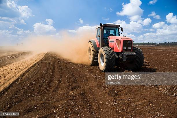 in the field - tractor stock pictures, royalty-free photos & images