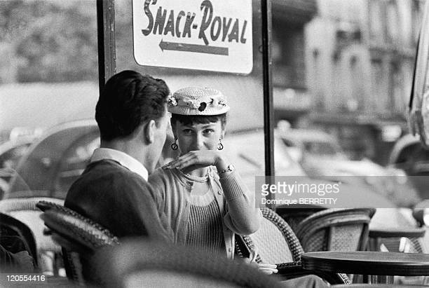 In The Fifties In Paris France Couple at the terrace of a cafe