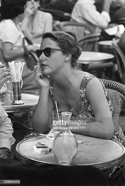 In The Fifties In Paris France womanat the terrace of a cafe
