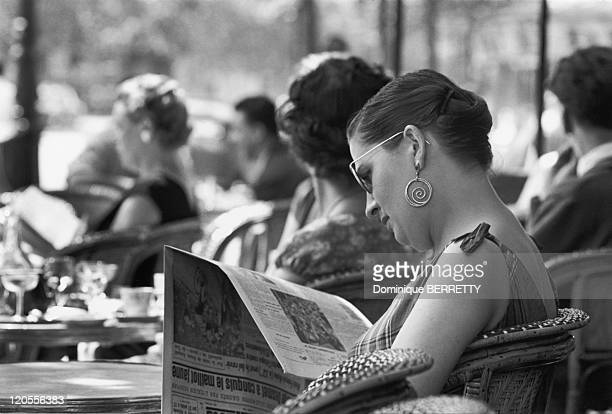 In The Fifties In Paris France womanseated at a cafe's terrace