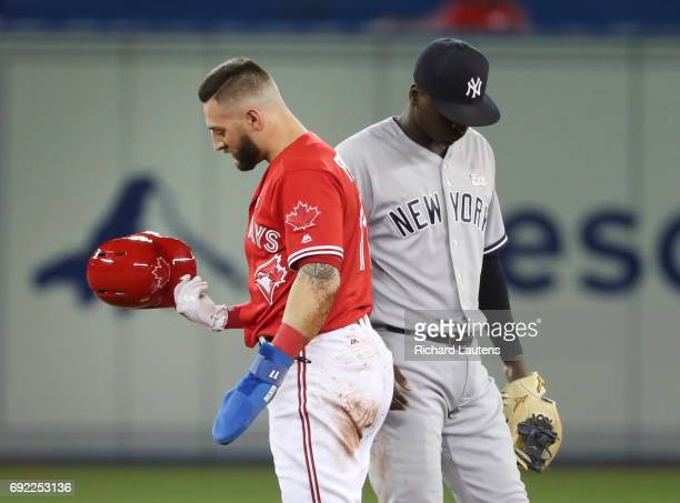 TORONTO ON JUNE 4 In the first inning Toronto Blue Jays center fielder Kevin Pillar took a throw off his helmet but is safe at second on a steal and...