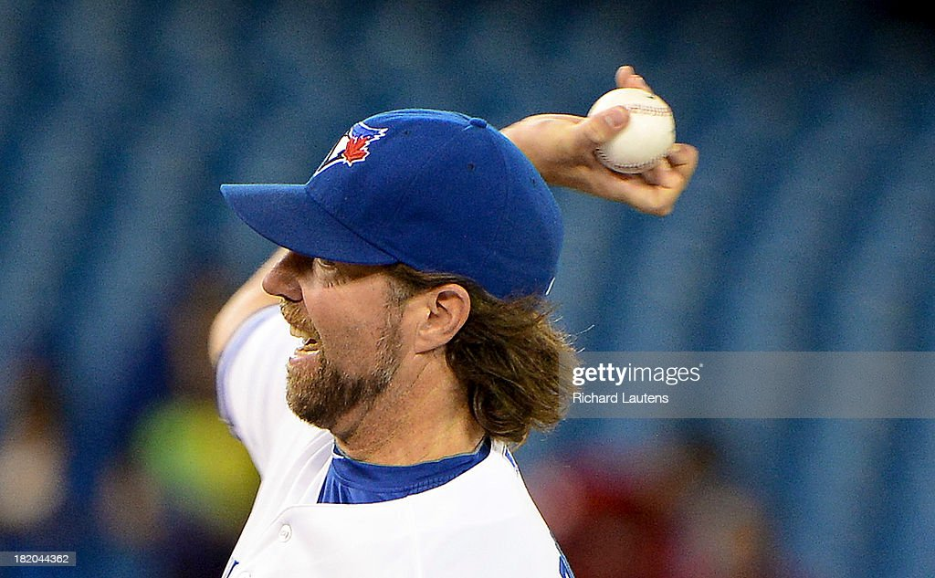 TORONTO, ON - SEPTEMBER 27 - In the first inning, Toronto Blue Jays starting pitcher R.A. Dickey (43) throws a knuckler. The Toronto Blue Jays took on the Tampa Bay Rays at the Rogers Centre in Toronto. It is the first game of the Jays' last home series of the season and while they are out of playoff contention, have the chance of playing spoiler for the Rays. The Rays can clinch a playoff birth with a victory. September 27, 2013.