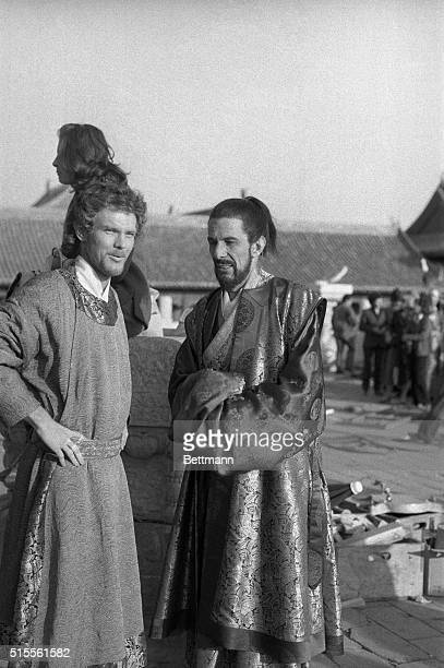 In the Forbidden City area actor Ken Marshall playing the title role in the NBCTV's 8hour moviefortelevision production of Marco Polo talks with...