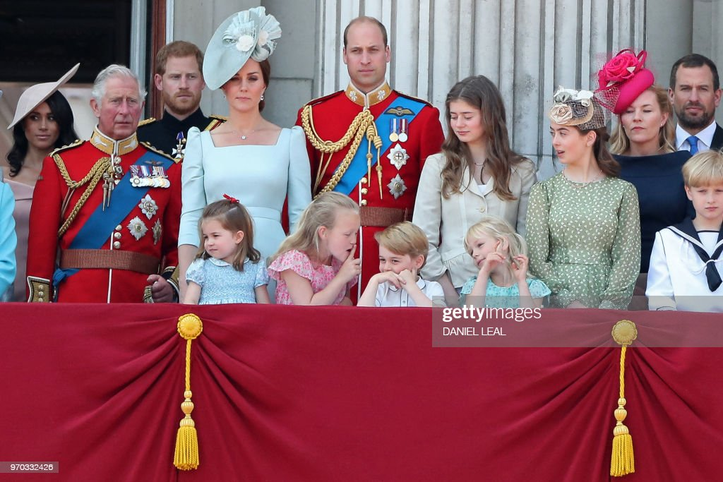 TOPSHOT - In the front row (L-R), children, Princess Charlotte of Cambridge, Savannah Phillips, Prince George of Cambridge and Isla Phillips chat on the balcony of Buckingham Palace as members of the Royal Family gather to watch a fly-past of aircraft by the Royal Air Force, in London on June 9, 2018. - The ceremony of Trooping the Colour is believed to have first been performed during the reign of King Charles II. In 1748, it was decided that the parade would be used to mark the official birthday of the Sovereign. More than 600 guardsmen and cavalry make up the parade, a celebration of the Sovereign's official birthday, although the Queen's actual birthday is on 21 April.