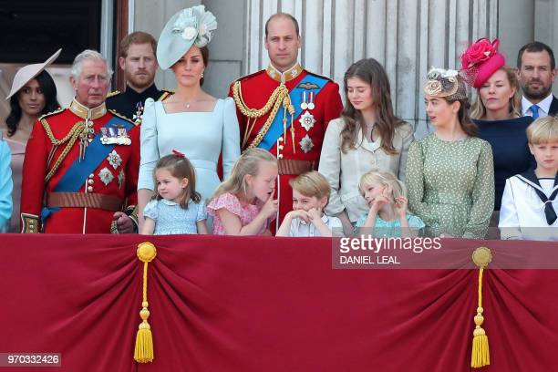In the front row , children, Princess Charlotte of Cambridge, Savannah Phillips, Prince George of Cambridge and Isla Phillips chat on the balcony of...