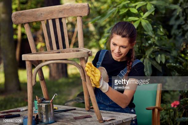 diy in the garden. grinding wooden chair - diy stock pictures, royalty-free photos & images
