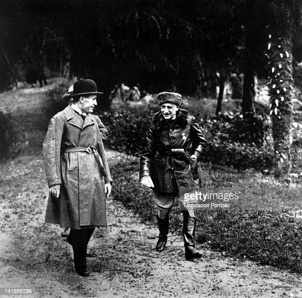 In the garden of Cargnacco Villa Gabriele D'Annunzio Italian poet and writer walking with Benito Mussolini Gardone Riviera May 1925