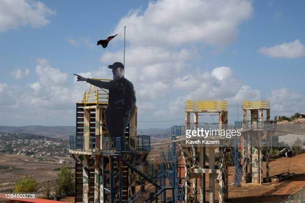 In the Garden of Iran built by the Iranian government and next to a Palestinian flag seen amass a large cutout figure of general Qasem Soleimani who...