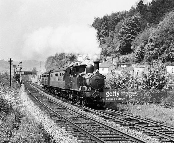 In the Golden Valley, 1400 class 0-4-2T, Number 1472 accelerates from St Mary's Crossing halt with a Gloucester-to-Chalford train.
