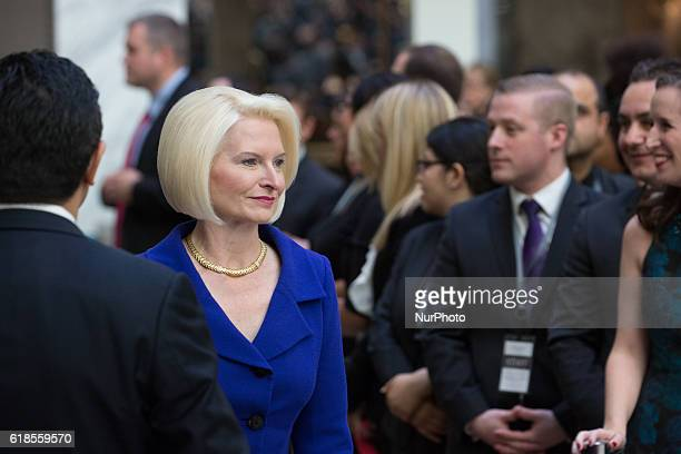 in the grand lobby of Trump International Hotel Callista Gingrich wife of Newt Gingrich former Speaker of the House arrives for the ribbon cutting...