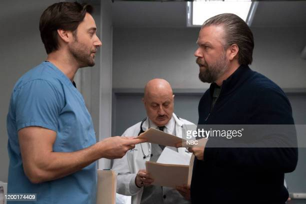 NEW AMSTERDAM In The Graveyard Episode 213 Pictured Ryan Eggold as Dr Max Goodwin Anupam Kher as Dr Vijay Kapoor Tyler Labine as Dr Iggy Frome