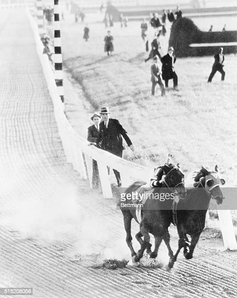 In the greatest match race in history Seabiscuit on the inside and ridden by George Woolf tears away from War Admiral ridden by Charlie Kurtsinger...