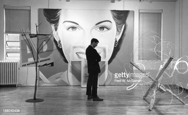 In the Green Gallery art dealer Richard Bellamy contemplates a sculpture New York New York January 28 1964