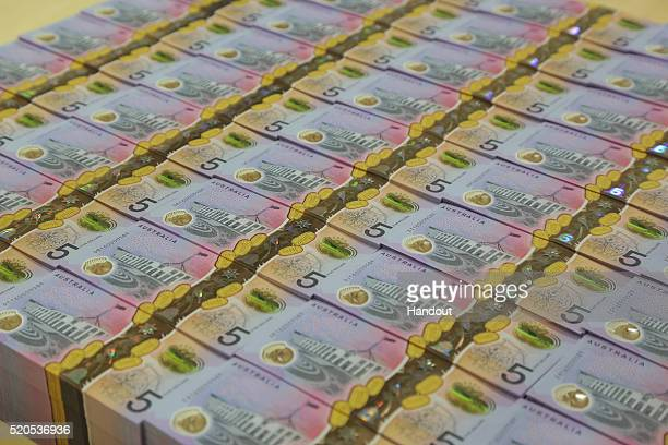 In the handout image provided by the Reserve Bank of Australia stacks of new $5 banknote is on display The Reserve Bank of Australia today released...