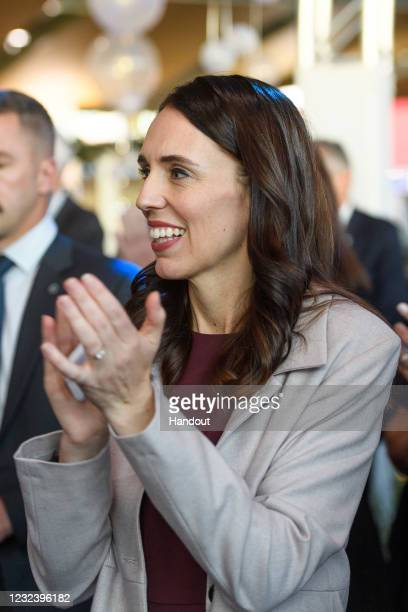 In the handout image provided by Wellington International Airport, New Zealand Prime Minister Jacinda Ardern applauds the Australian High...