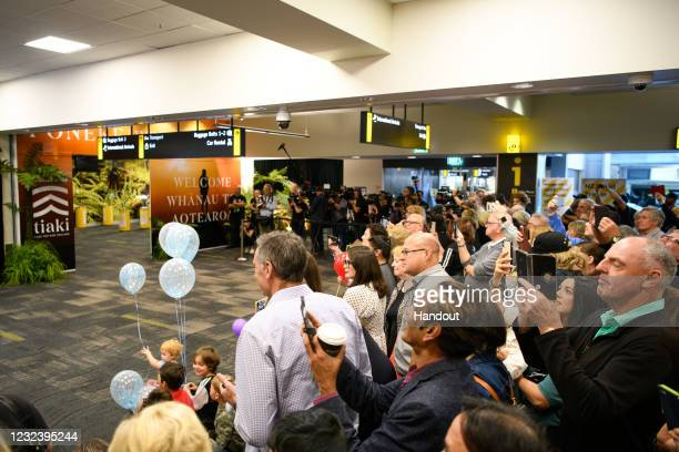 In the handout image provided by Wellington International Airport, media, family members and spectators wait inside the terminal for passages to...