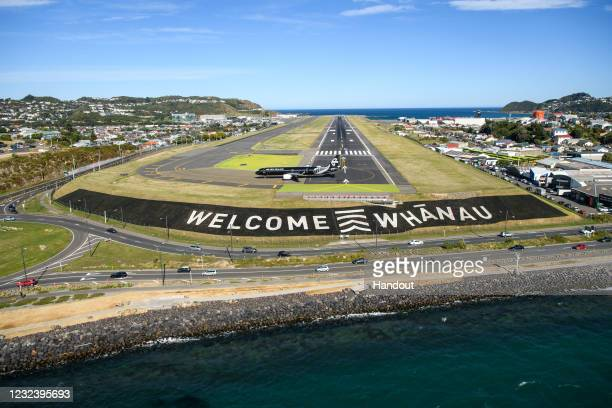 In the handout image provided by Wellington International Airport, the first trans-Tasman bubble flight from Australia to Wellington lands at...