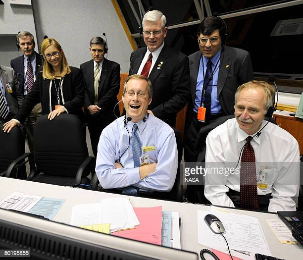 In the handout photo provided by NASA Space Shuttle Program Manager John Shannon Associate Administrator for Space Operations Bill Gerstenmaier NASA...