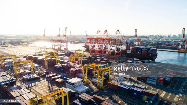in the harbor containers are arranged and trade is taking place. - prosperity stock photos and pictures