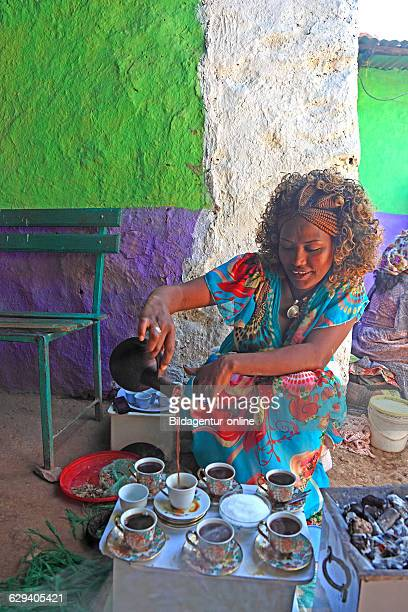 In the highlands of Abyssinia in the village of Sina young woman prepares coffee for the coffee ceremony