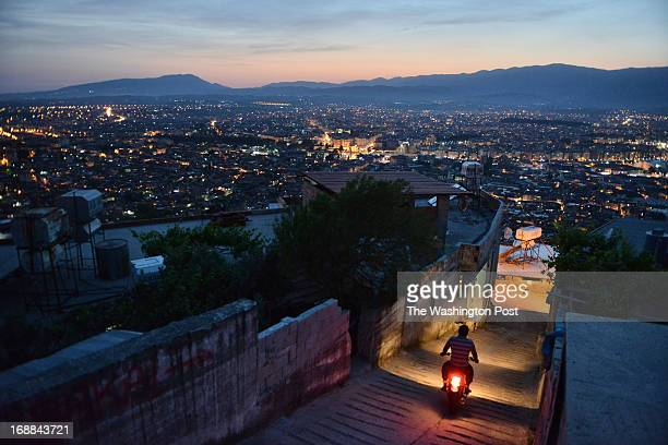 In the hills above the city a man passes through an alley on Friday May 3 in Antakya Turkey Turkey is facing one of the world's largest refugee...