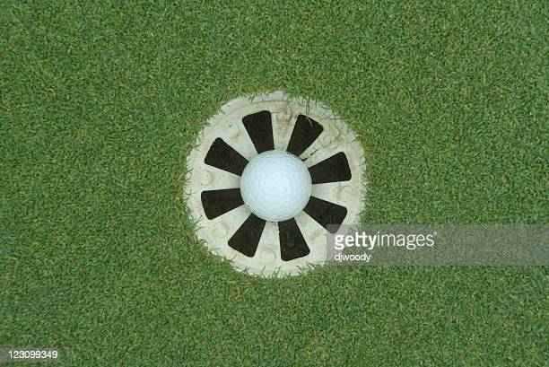 in the hole - birdie golf stock photos and pictures