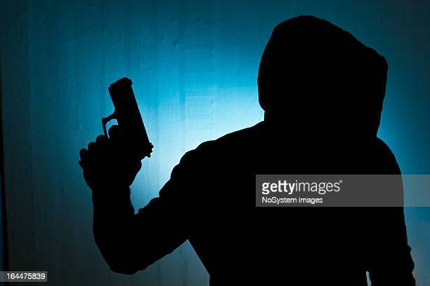 in the hood - armed robbery stock photos and pictures