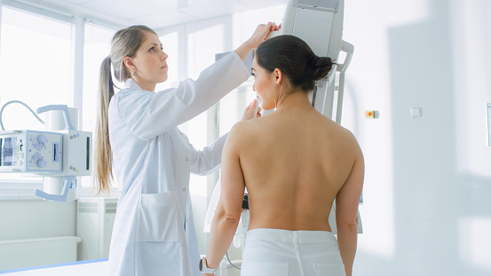 In the Hospital, Female Patients Undergoes Mammogram Screening Procedure Done by Mammography Technologist. Modern Technologically Advanced Clinic with Professional Doctors. Breast Cancer Prevention Screening. 996271418