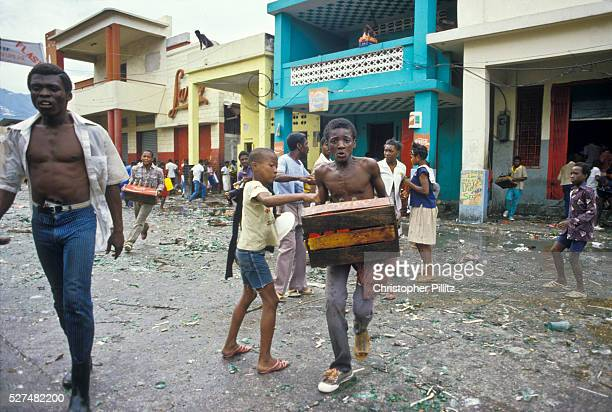 In the immediate aftermath of the flight into French exile of the Haitian president 'Baby Doc' Duvalier residents in the city of PortauPrince go on...