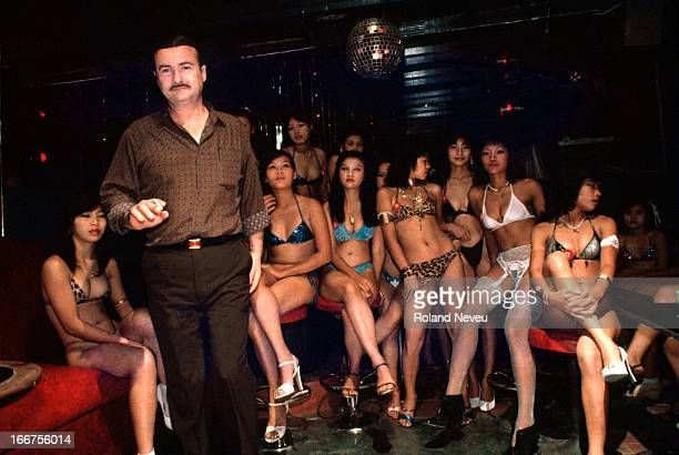 In the infamous bar strip of Patpong a foreign barowner and his stable of gogo dancers before the start of the night Patpong's steamy nightlife has...