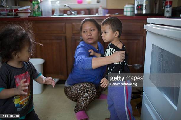 In the kitchen Dipson Gurung argues with his cousin Sajal as the latter's mother Tika holds him Burlington Vermont January 5 2016 Members of the...