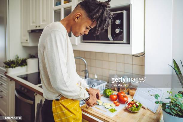 in the kitchen - vegetarian food stock pictures, royalty-free photos & images