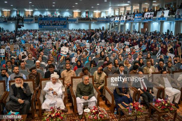 In the large meeting room originally dedicated to the loya jirga, Dr. Abdullah in the center and on his left, Farkhunda Zahra Naderi, member of his...