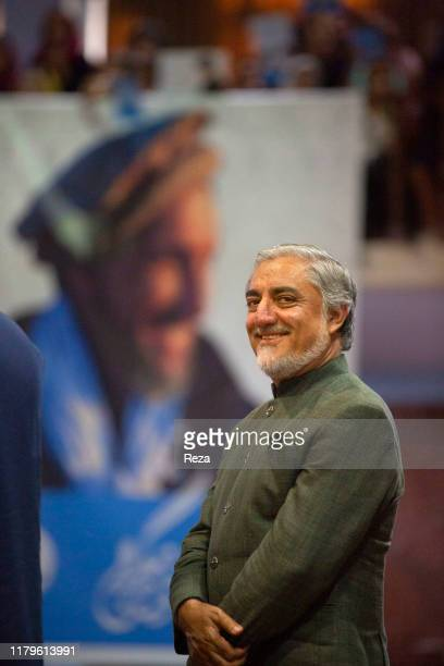 In the large meeting room originally dedicated to the loya jirga Dr Abdullah poses in front of a poster of Commander MassoudDr Abdullah Abdullah is...