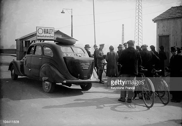 In the line of the free zone in the occupied zone civilians traveling in the occupied zone and are checking their identity documents by the Nazis...