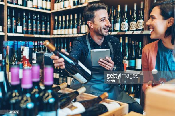 in the liquor shop - liquor store stock pictures, royalty-free photos & images